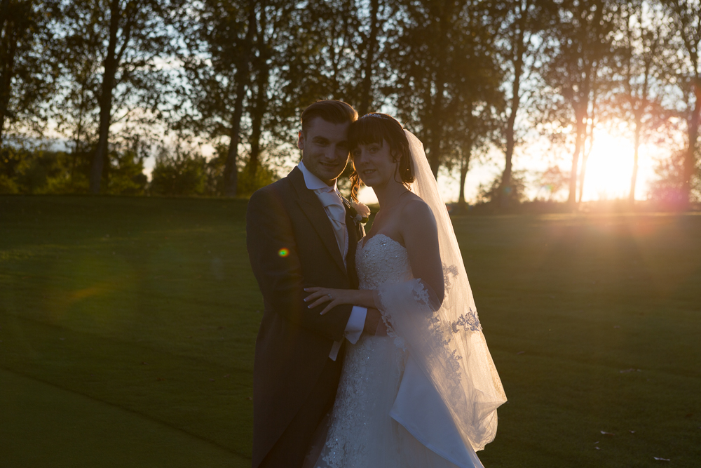 Bride and groom at Sunset at Birchwood Park