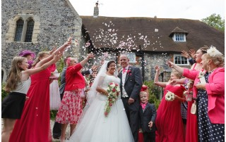 Bride and groom confetti shower