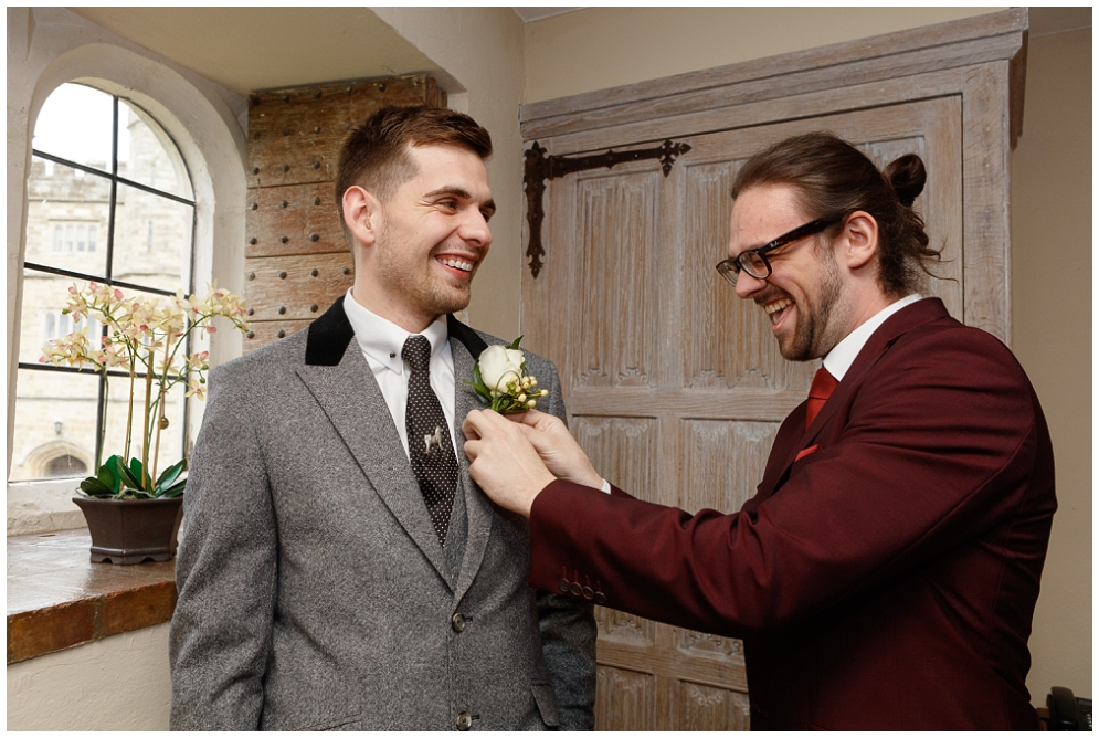 Best man helps groom with Buttonhole
