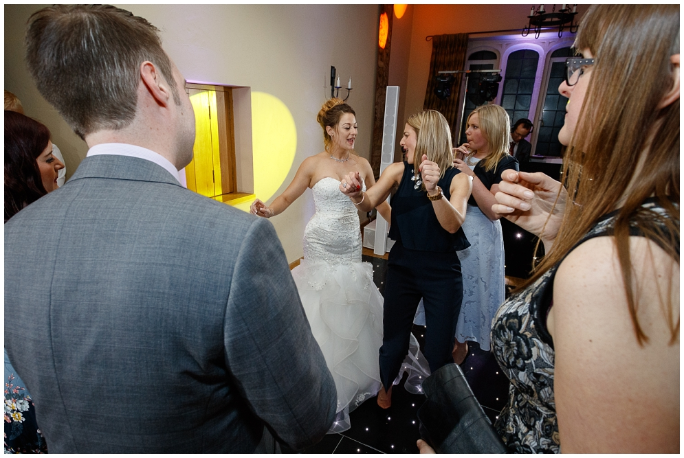 Bride dancing with girlfriends